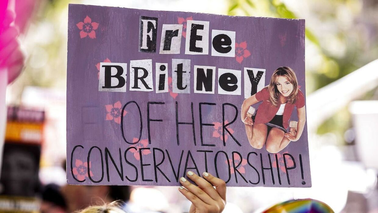 A demonstrator holds a poster reading 'Free Britney of her Conservatorship' during a #FREEBRITNEY protest in front of the court house where a hearing is scheduled in the Britney Spears' conservatorship case in Los Angeles, California, USA, 14 July 2021.