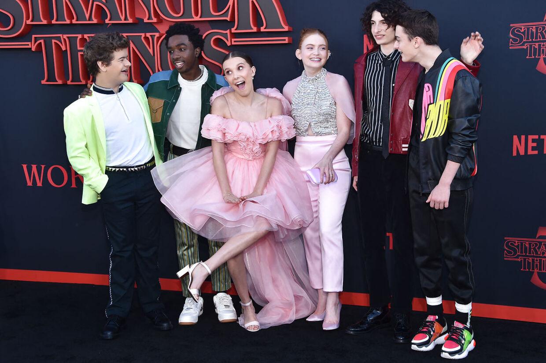 17-årige Millie Bobby Brown brød igennem med Netflix-serien 'Stranger Things'. Her ses hun med sine medskuespillere Gaten Matarazzo, Caleb McLaughlin, Sadie Sink, Finn Wolfhard og Noah Schnapp til premieren på 'Stranger Things 3' i 2019.