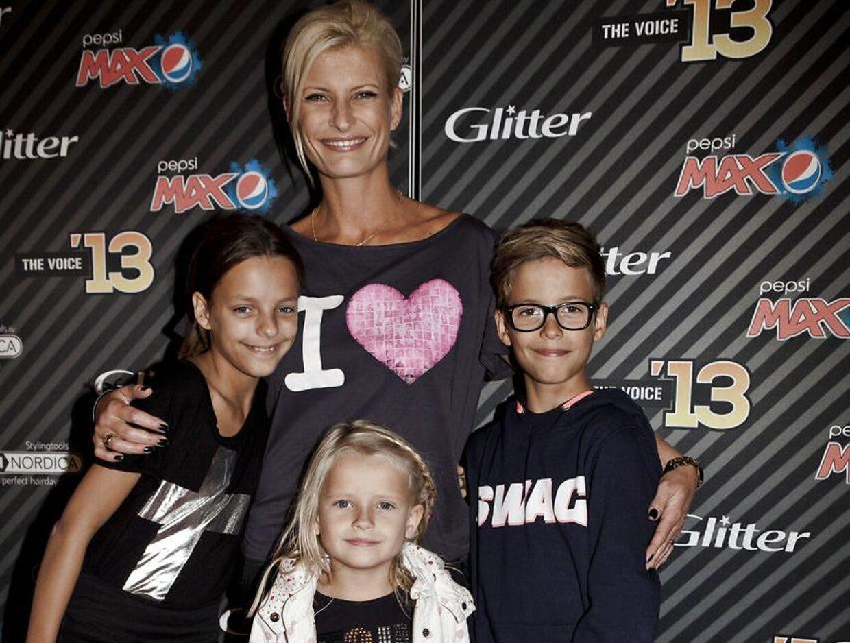 TArkivfoto fra 2013 af Mai-Britt Vingsøe med hendes tre børn.