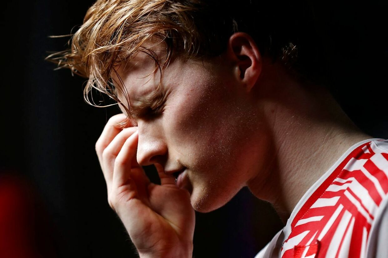Denmark's Anders Antonsen talks to the media after losing to Denmark's Viktor Axelsen during their men's singles semi-final match on day four of the All England Open Badminton Championship at the Utilita Arena in Birmingham, central England, on March 20, 2021. (Photo by Adrian DENNIS / AFP)