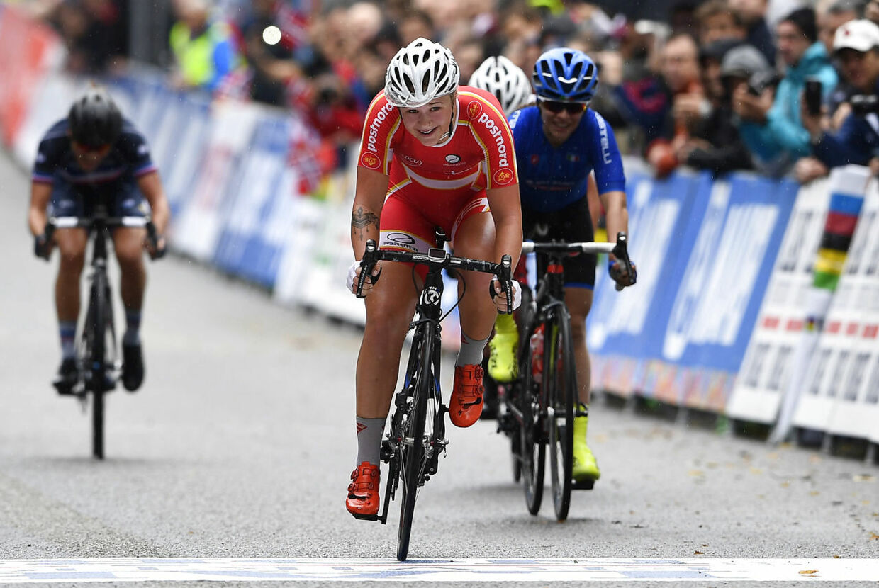 Silver medalist Emma Cecilie Norsgaard Jorgensen of Denmark (C) and bronze medalist Letizia Paternoster of Italy (R) cross the finish line after the UCI Cycling Road World Championships Women Junior Road Race in Bergen, on September 22, 2017. / AFP PHOTO / Jonathan NACKSTRAND