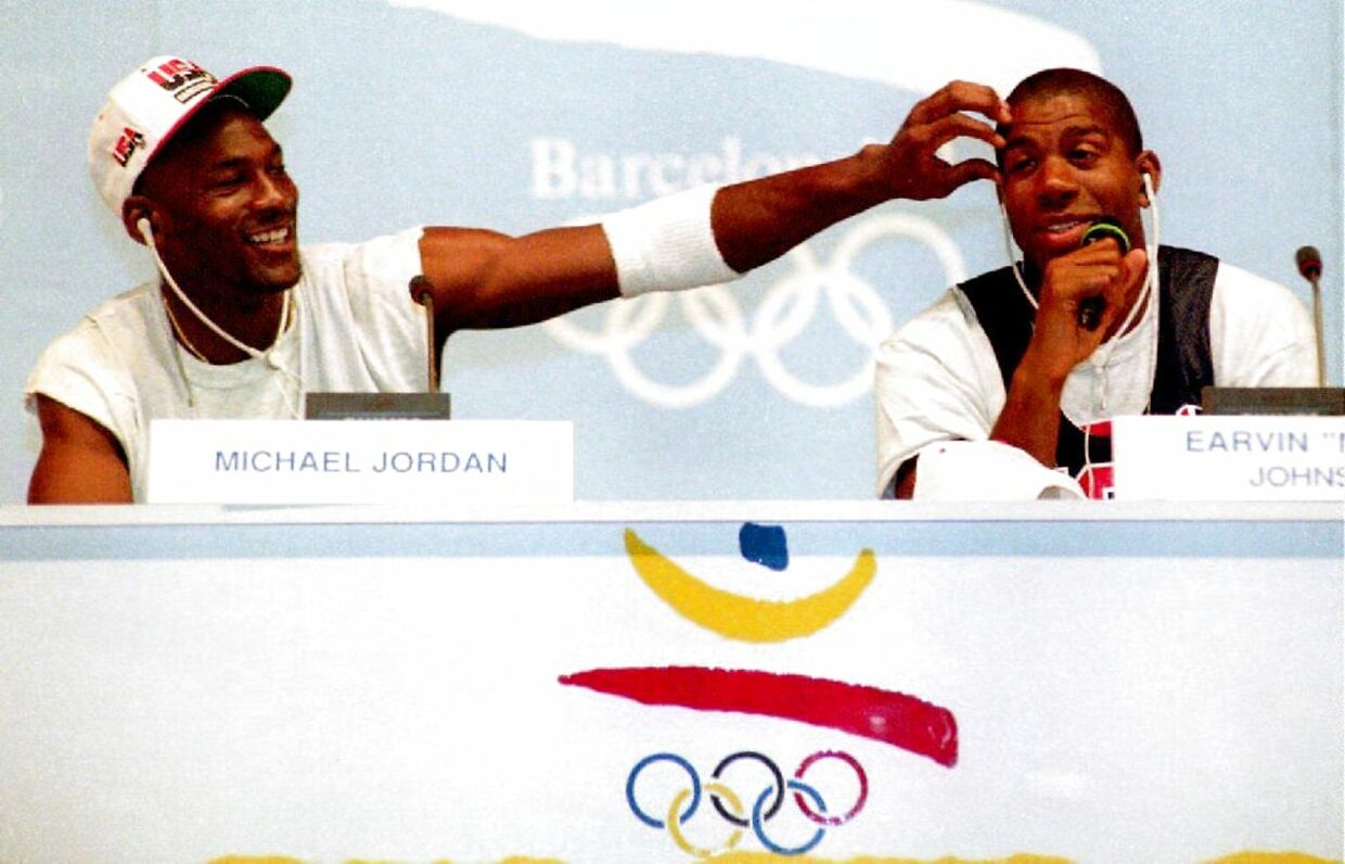 """Basketball stars Michael Jordan (L) and Earvin """"Magic"""" Johnson clown for the media 25 July during a press conference for the U.S. Olympic """"Dream Team."""" The team is strongly favored to win the gold."""