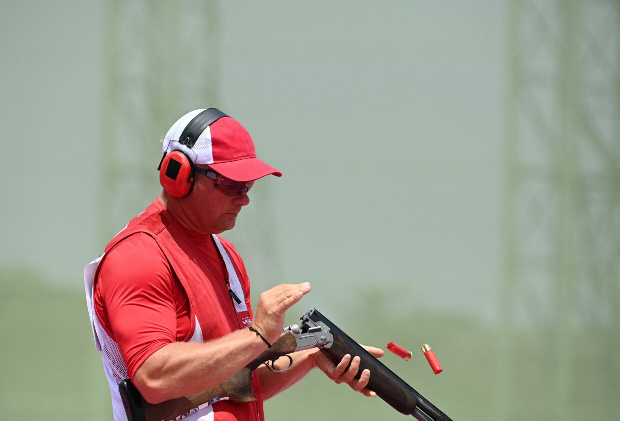 Denmark's Jesper Hansen competes in the men's skeet qualification during the Tokyo 2020 Olympic Games at the Asaka Shooting Range in the Nerima district of Tokyo on July 26, 2021. (Photo by Tauseef MUSTAFA / AFP)