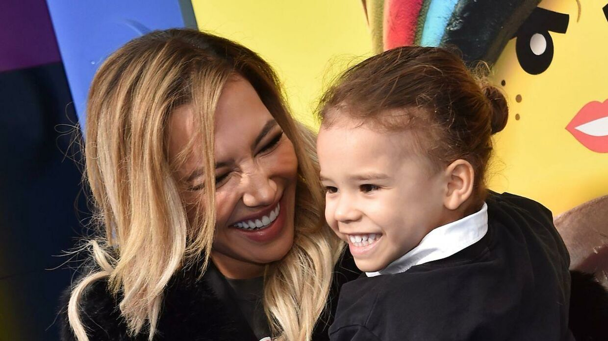 """(FILES) In this file photo US actress Naya Rivera and son Josey Hollis Dorsey arrive for the premiere of """"The Lego Movie 2: The Second Part"""" at the Regency Village theatre on February 2, 2019 in Westwood, California. - """"Glee"""" star Naya Rivera is missing and feared drowned at a California lake, where divers, patrol boats and helicopters resumed their search for the US actress on July 9, 2020. The operation to locate the 33-year-old - - a """"possible drowning victim"""" - - began at first light at Lake Piru, around an hour's drive northwest of Los Angeles. Rivera, best known for her role as high school cheerleader Santana Lopez in """"Glee"""", disappeared Wednesday after renting a boat at the camping and recreational hotspot with her four-year-old son. (Photo by Chris Delmas / AFP)"""