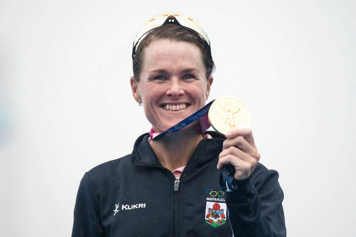 Bermuda's Flora Duffy poses with her gold medal on the podium after winning the women's individual triathlon competition during the Tokyo 2020 Olympic Games at the Odaiba Marine Park in Tokyo on July 27, 2021. (Photo by Loic VENANCE / AFP)