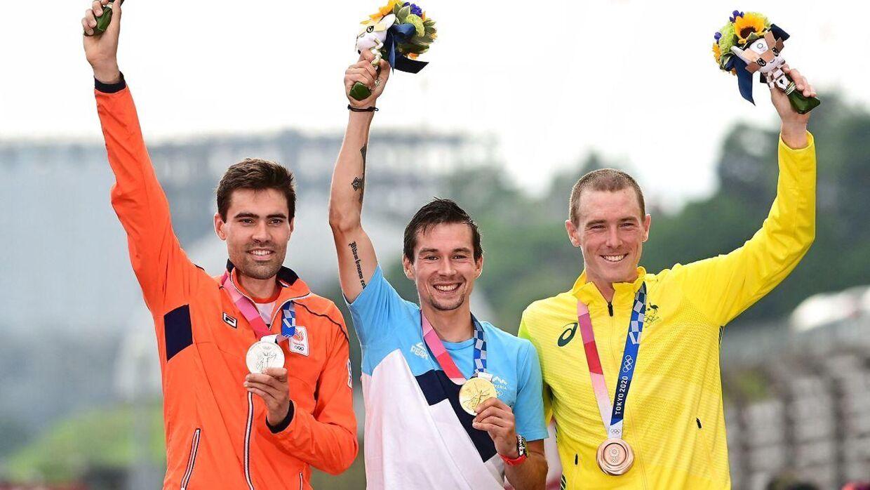 Primoz Roglic sikrede sig guld, mens australske Rohan Dennis (th.) og hollandske Tom Dumoulin (tv.) sikrede sig henholdsvis sølv og bronze.