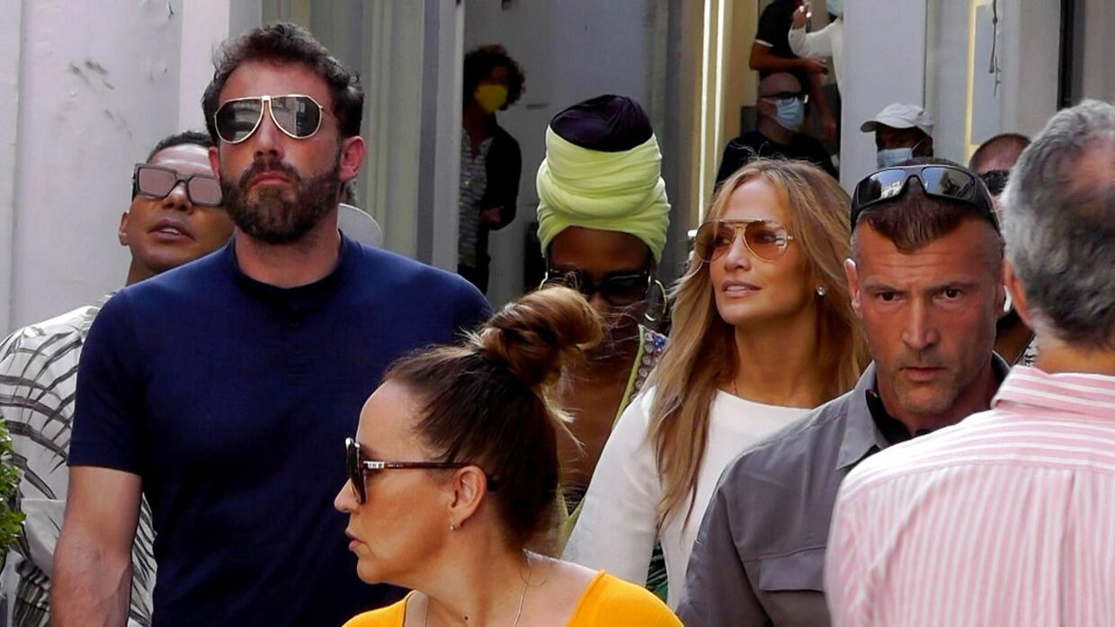 epa09373725 US singer/actress Jennifer Lopez (C-R) and US actor/director Ben Affleck (C-L) walk the streets of Capri, near Naples, Italy, 28 July 2021. The couple arrived on the island aboard the luxury yacht 'Valerie'. EPA/Giuseppe Catuogno