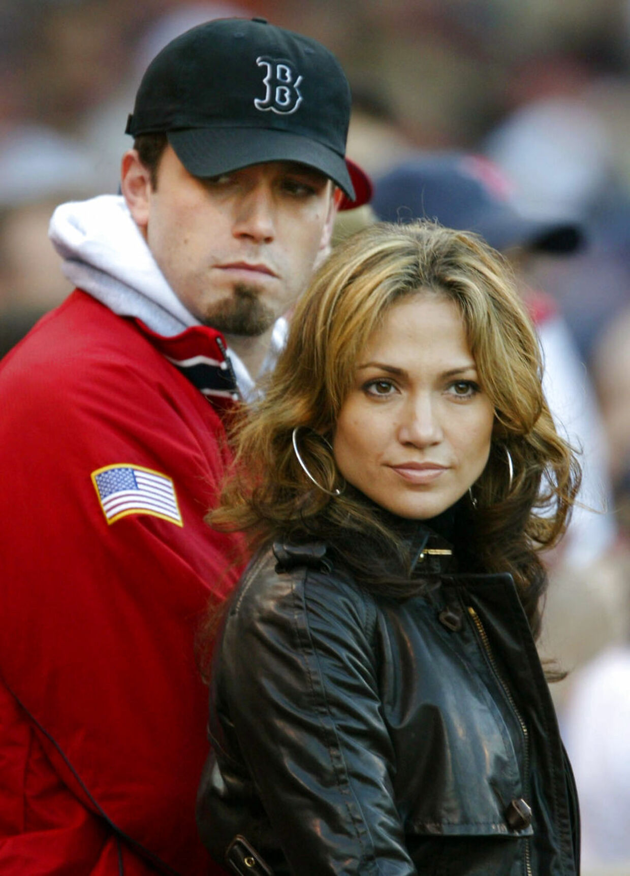 File ntertainers Jennifer Lopez and Ben Affleck are seen during an American League Championship series baseball game at Boston's Fenway Park, on October 11, 2003. The much ballyhooed engagement of movie stars Lopez and Affleck has been officially called off, a spokesman for the singer/actress said on January 22, 2004. The celebrity couple were supposed to marry last September but at the last minute called the wedding off, blaming the postponement on the media frenzy their planned nuptials had created. Since then they have been seen together in public many times, although there were widespread rumors that they were splitting up. REUTERS/Mike Segar/FILE