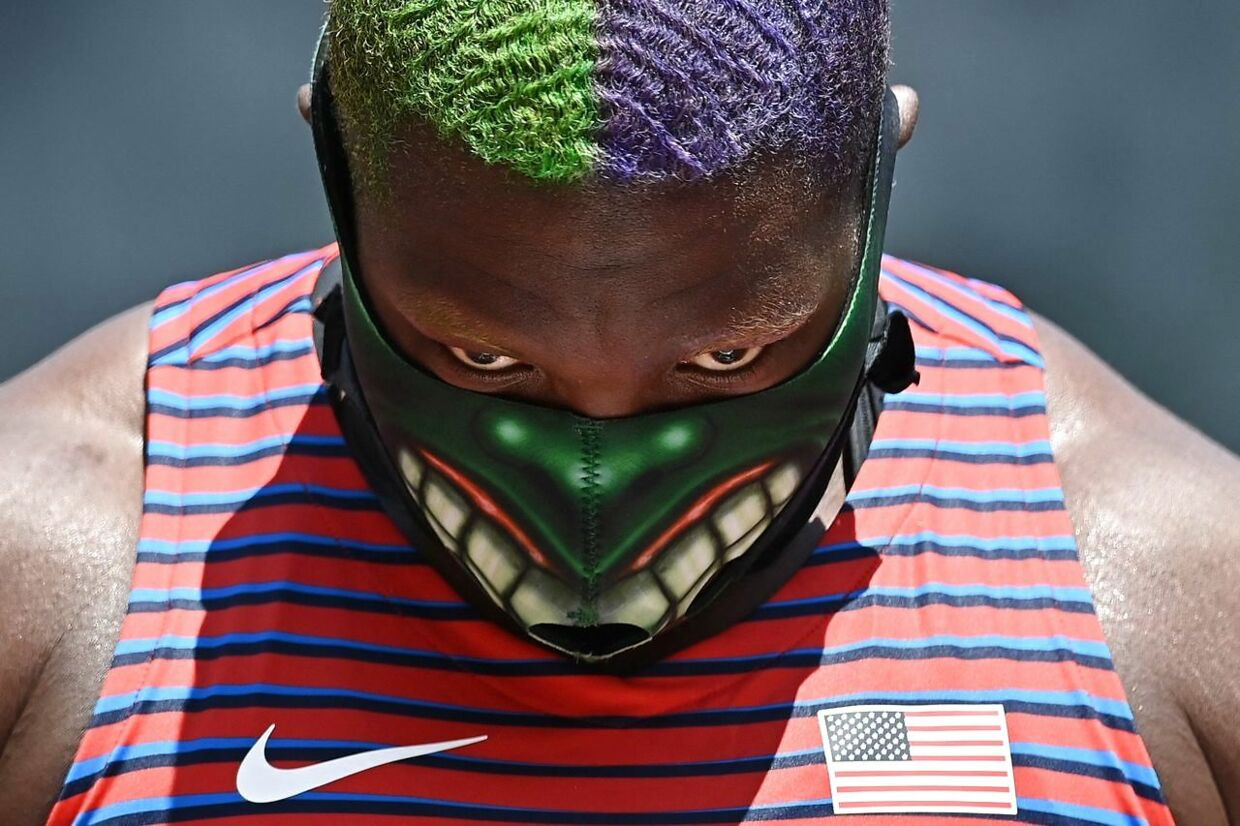 TOPSHOT - USA's Raven Saunders reacts as she competes in the women's shot put final during the Tokyo 2020 Olympic Games at the Olympic Stadium in Tokyo on August 1, 2021. (Photo by Ben STANSALL / AFP)