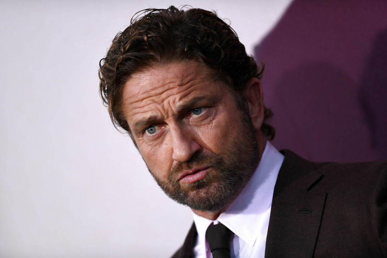 """Scottish actor Gerard Butler arrives for the Los Angeles premiere of """"Angel Has Fallen"""" at the Regency Village theatre on August 20, 2019 in Westwood, California. VALERIE MACON / AFP"""
