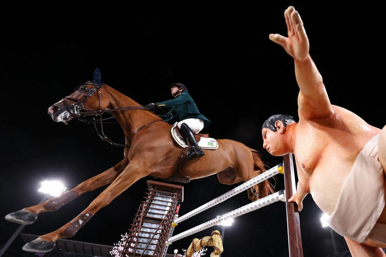 Brazil's Marlon Modolo Zanotelli riding Edgar M competes in the equestrian's jumping individual qualifying during the Tokyo 2020 Olympic Games at the Equestrian Park in Tokyo on August 3, 2021. (Photo by Behrouz MEHRI / AFP)