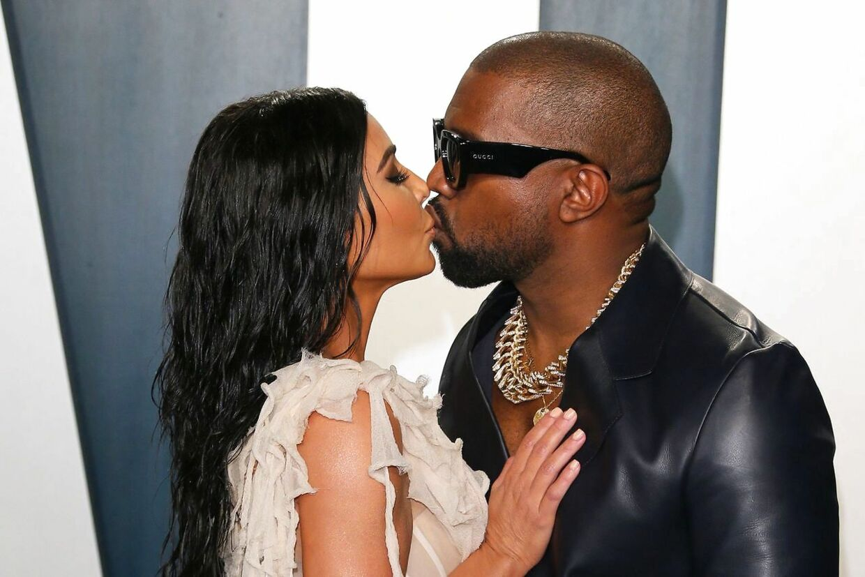 """(FILES) In this file photo US media personality Kim Kardashian (L) and former husband US rapper Kanye West attend the 2020 Vanity Fair Oscar Party following the 92nd Oscars at The Wallis Annenberg Center for the Performing Arts in Beverly Hills on February 9, 2020. - Music icon Kanye West has filed to legally change his name to his longtime nickname """"Ye, """" US media reported on August 25, 2021, citing documents filed in a Los Angeles court. The 44-year-old wants to change his full name - - Kanye Omari West - - to the two-letter Ye, with no middle or last name, according to NBC News and other US media. The change was requested for """"personal reasons"""" and must be approved by a judge, NBC said. (Photo by Jean-Baptiste Lacroix / AFP)"""