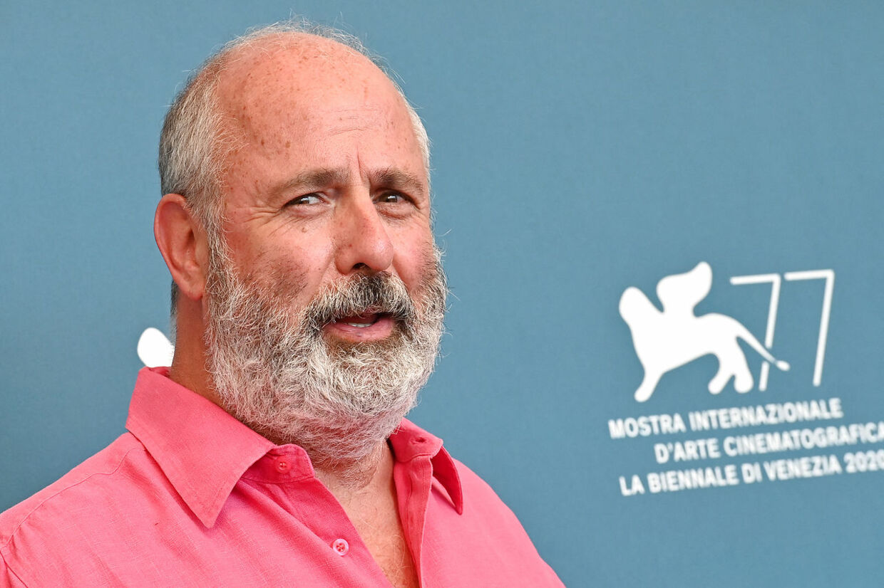 """South-African director Roger Michell attends a photocall for the film """"The Duke"""" presented out of competition on the third day of the 77th Venice Film Festival, on September 4, 2020 at Venice Lido, during the COVID-19 infection, caused by the novel coronavirus.  Alberto PIZZOLI / AFP"""