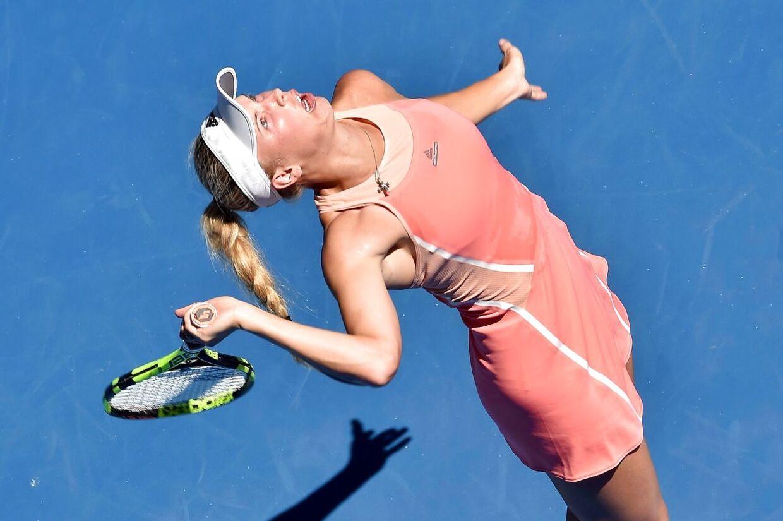 Caroline Wozniacki spiller sin første kamp ved Australian Open mandag morgen dansk tid.