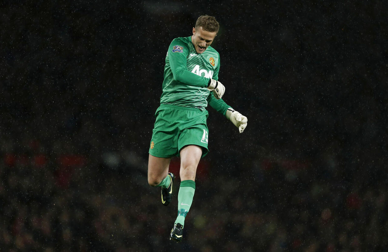 Football - Manchester United v Norwich City - Capital One Cup Fourth Round - Old Trafford - 29/10/13 Manchester United's Anders Lindegaard celebrates as his side are awarded a penalty Mandatory Credit: Action Images / Andrew Couldridge Livepic EDITORIAL USE ONLY. No use with unauthorized audio, video, data, fixture lists, club/league logos or live services. Online in-match use limited to 45 images, no video emulation. No use in betting, games or single club/league/player publications. Please contact your account representative for further details.