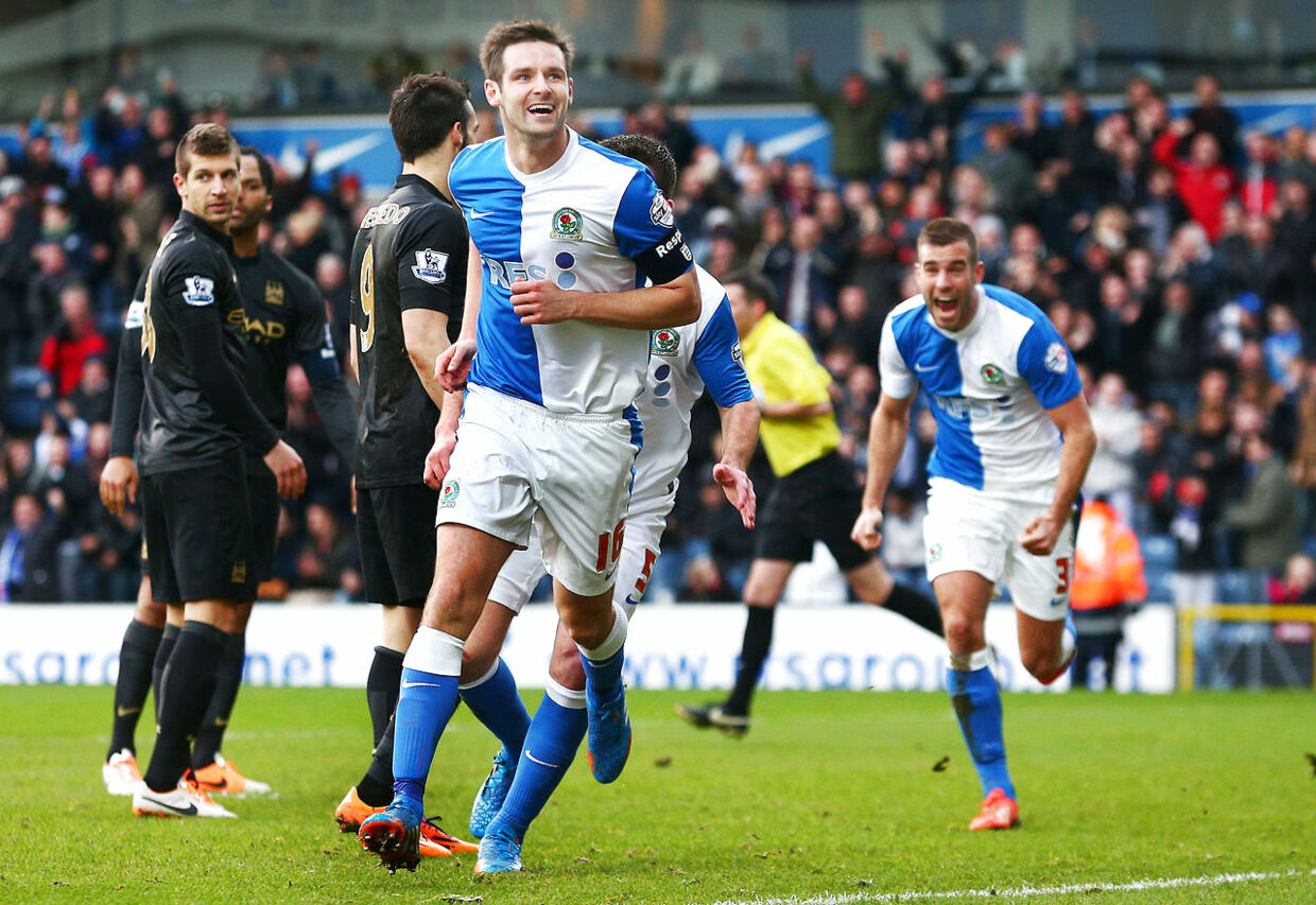 Football - Blackburn Rovers v Manchester City - FA Cup Third Round - Ewood Park - 4/1/14 Scott Dann of Blackburn Rovers celebrates scoring their first goal Mandatory Credit: Action Images / Jason Cairnduff Livepic EDITORIAL USE ONLY. No use with unauthorized audio, video, data, fixture lists, club/league logos or live services. Online in-match use limited to 45 images, no video emulation. No use in betting, games or single club/league/player publications. Please contact your account representative for further details.