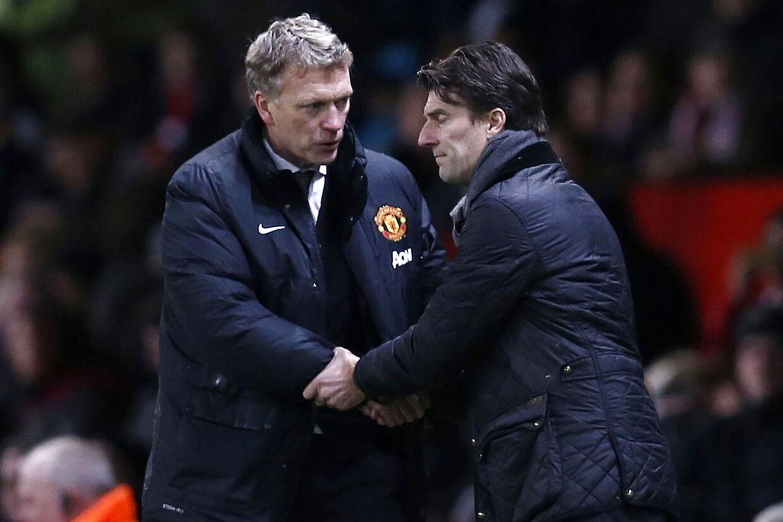 David Moyes og Michael Laudrup trykker hænder efter at søndagens opgør i FA Cuppen. I weekenden mødes de igen.