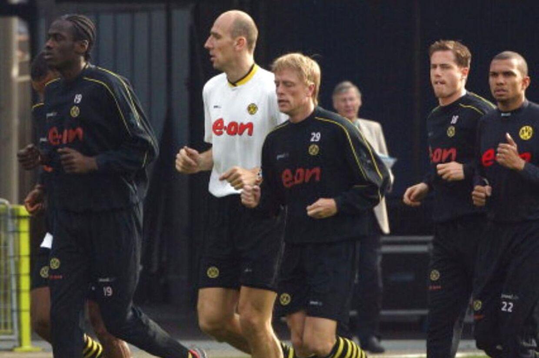 Tysk-ghanesiske Otto Addo til venstre i billedet fra tiden som spiller i Borussia Dortmund. Han er nu en del af trænerstaben i FC Nordsjælland.