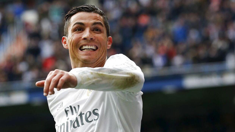 Football Soccer - Real Madrid v Sporting Gijon - Spanish Liga BBVA - Santiago Bernabeu, Madrid, Spain - 17/01/16 Real Madrid's Cristiano Ronaldo celebrates his second goal against Sporting Gijon. REUTERS/Andrea Comas