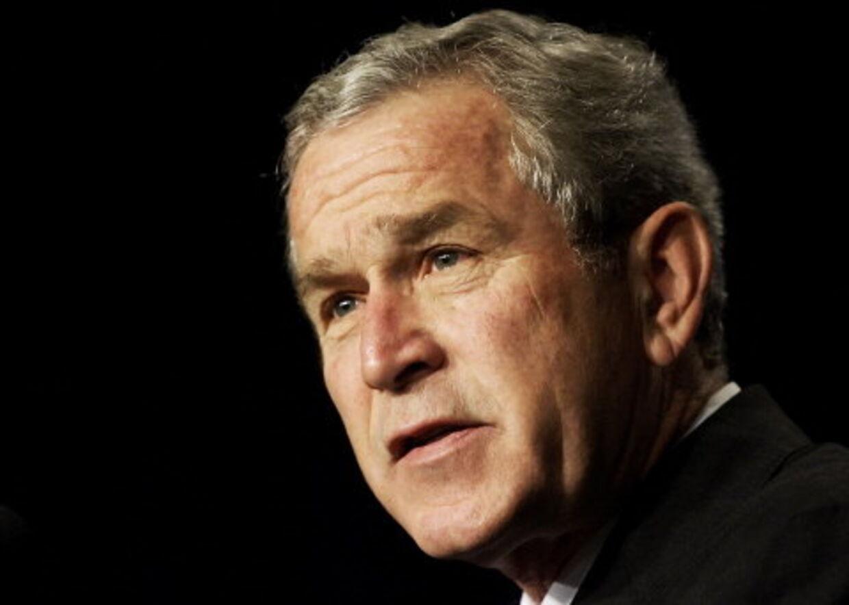 Bush har gjort meget godt mener rockband. Foto: AFP