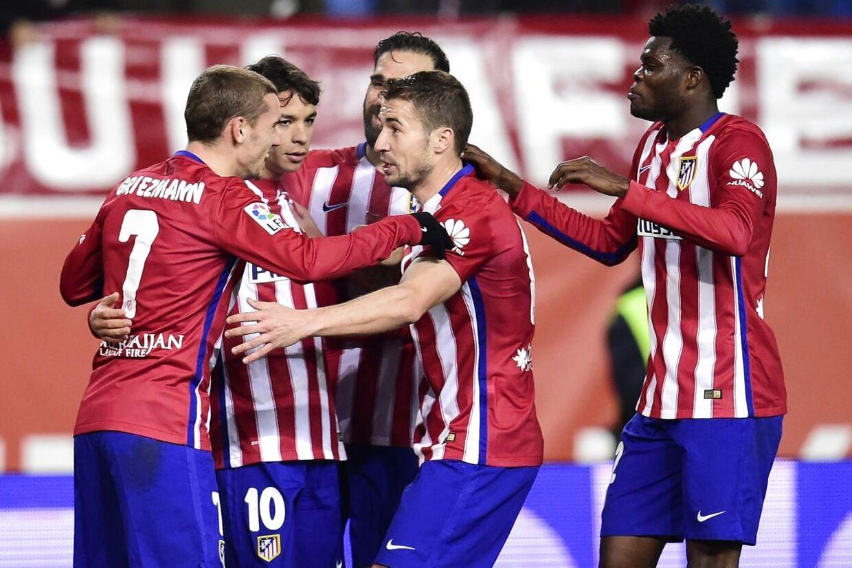 Atlético Madrid-spillerne jubler efter et mål i returopgøret i ottendedelsfinalen hjemme på Vicente Calderon mod Rayo Vallecano.