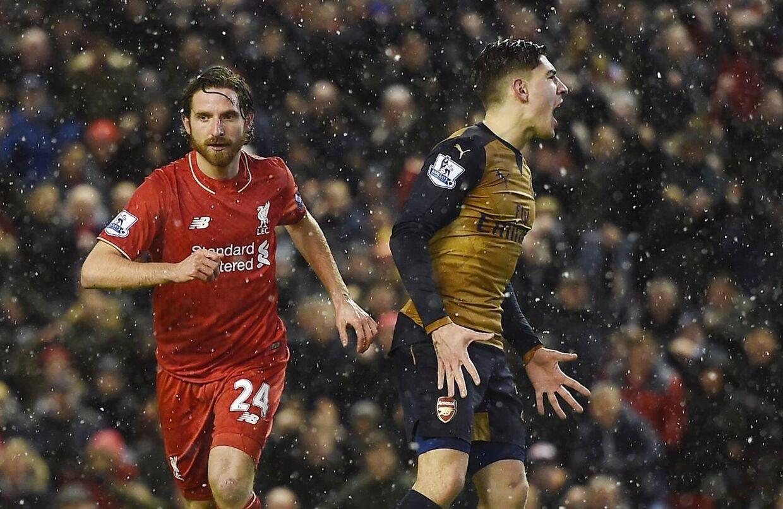 Liverpools Joe Allen fejrer at have udlignet til 3-3 mod Arsenal, som også blev kampens resultat.