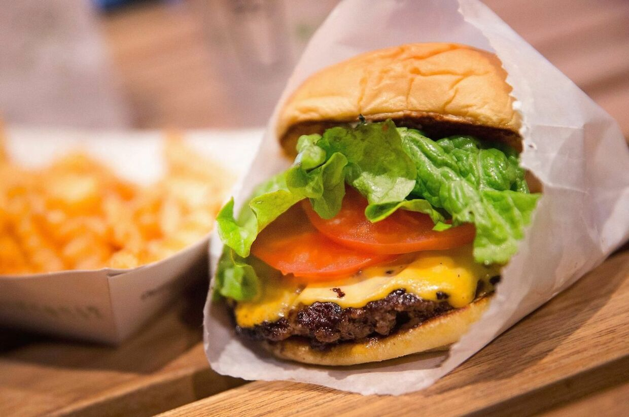 CHICAGO, IL - JANUARY 28: In this photo illustration a cheeseburger and french fries are served up at a Shake Shack restaurant on January 28, 2015 in Chicago, Illinois. The burger chain, with currently has 63 locations, is expected to go public this week with an IPO priced between $17 to $19 a share. The company will trade on the New York Stock Exchange under the ticker symbol SHAK. (Photo Illustration by Scott Olson/Getty Images/AFP == FOR NEWSPAPERS, INTERNET, TELCOS & TELEVISION USE ONLY ==
