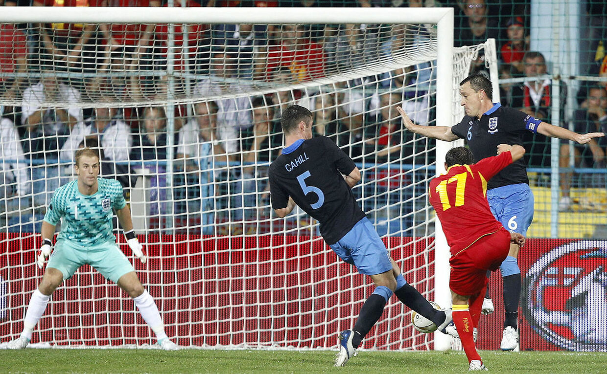 Montenegro's Elsad Zverotic (2nd R) shoots to score against England during their Euro 2012 Group G qualifying soccer match in Podgorica, October 7, 2011. REUTERS/Darren Staples (MONTENEGRO - Tags: SPORT SOCCER)
