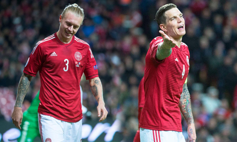 Simon Kjær og Daniel Agger (th.) skuffede over nederlaget til Frankrig i Parken søndag aften