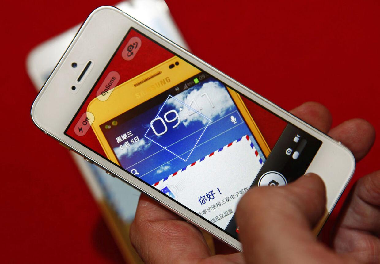 IT-giganten Apple beskyldes for at gøre gamle produkter langsommere med vilje forud for lanceringen af nye for at folk til at købe en ny mobil. (Arkivfoto)