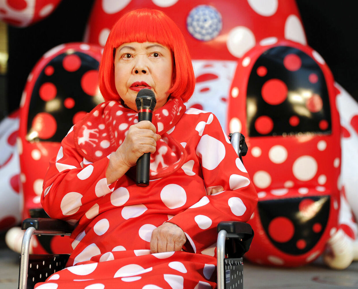 Japanese avant-garde artist Yayoi Kusama answers questions during a press preview for an 32-hour art event at Roppongi shopping district in Tokyo on March 22, 2012. AFP PHOTO/Toru YAMANAKA