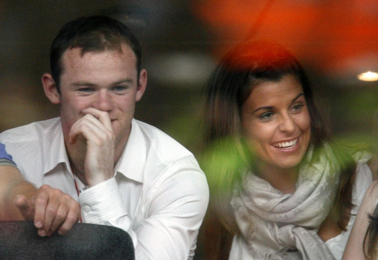 Manchester United soccer player Wayne Rooney (L) and fiancee Coleen McLoughlin watch a concert in Liverpool in this June 1, 2008 file photo. Rooney married his childhood sweetheart McLoughlin in front of family and friends at a 17th century villa on the Italian Riviera on June 12, 2008. REUTERS/Nigel Roddis/Files (BRITAIN)