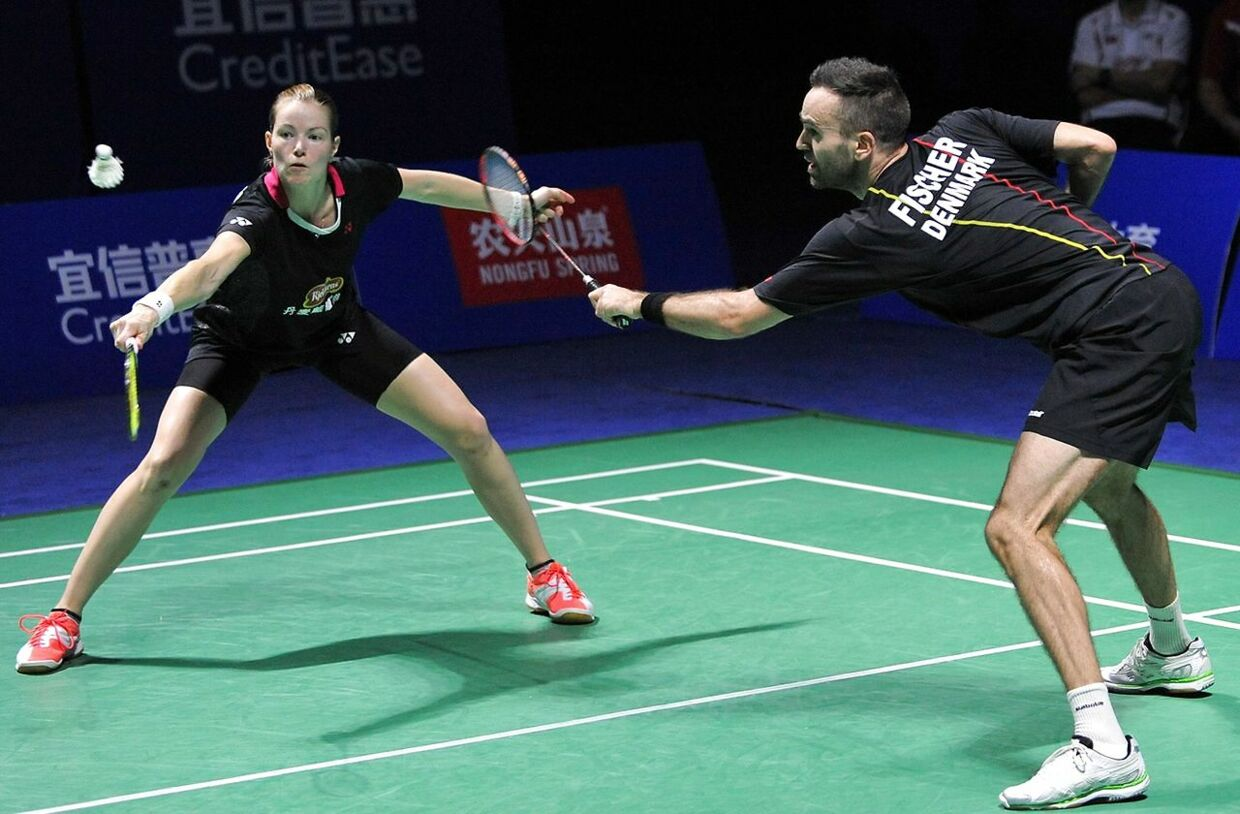 Christinna Pedersen (L) of Danmark hits a return as she partners Joachim Fischer Ni of Danmark during their mixed doubles final match against Zhang Nan and Zhao Yunlei of China at the China Open badminton tournament in Fuzhou, east China's Fujian province on November 15, 2015. CHINA OUT AFP PHOTO