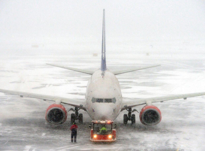 Sneen skaber kaos i Stockholms lufthavn Arlanda.
