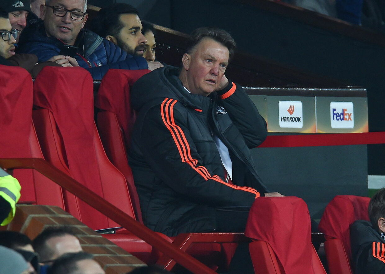 epa05217064 Manchester United manager Louis van Gaal reacts during the UEFA Europa League round of 16 soccer match between Manchester United and Liverpool at Old Trafford in Manchester, Britain, 17 March 2016. EPA/PETER POWELL
