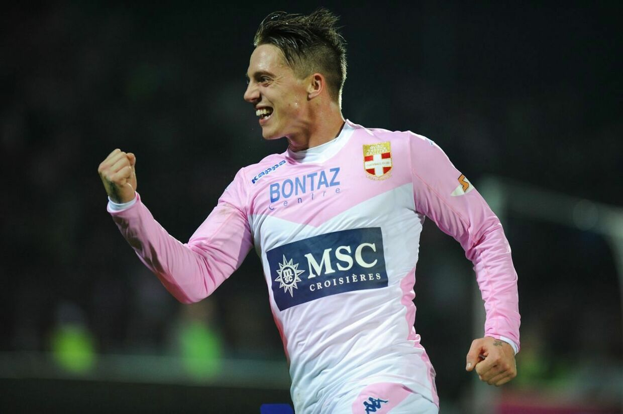 Evian's Danish forward Nicki Bille Nielsen celebrates after scoring during the French L1 football match Evian (ETGFC) against Guingamp (EAG) on November 30, 2014 at the stadium Parc des Sports in Annecy, southern France. AFP PHOTO / JEAN-PIERRE CLATOT