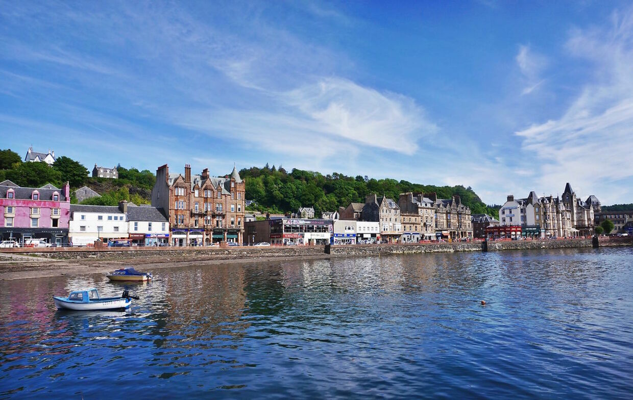 Oban, UK - June 14 2016: (EDITORIAL USE ONLY. CHINA OUT) Oban is a resort town within the Argyll and Bute council area of Scotland. Despite its small size, it is the largest town between Helensburgh and Fort William. During the tourist season, the town can play host to up to 25, 000 people. Oban occupies a setting in the Firth of Lorn. The bay is a near perfect horseshoe, protected by the island of Kerrera; and beyond Kerrera, the Isle of Mull. To the north, is the long low island of Lismore, and the mountains of Morvern and Ardgour. (Photo by ) *** Please Use Credit from Credit Field ***