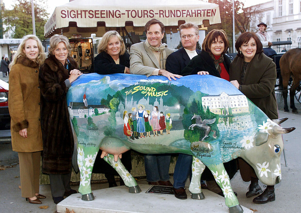 "Actors who played the children of the Trapp family in the legendary movie ""The Sound of Music"" pose in Salzburg on November 1, 2000. (L to R) Kym Gareth (Gretl), Charmian Carr (Liesl) (2nd L) , Angela Cartwright (Brigitta), Nicholas Hammond (Friedrich), Duane Chase (Kurt), Debbie Thurner (Martha) and Heather Menzis (Louisa) were re-united on the original film sets for a British television production 35 years after the movie was shot in the west Austrian province. REUTERS/Staff/Files"