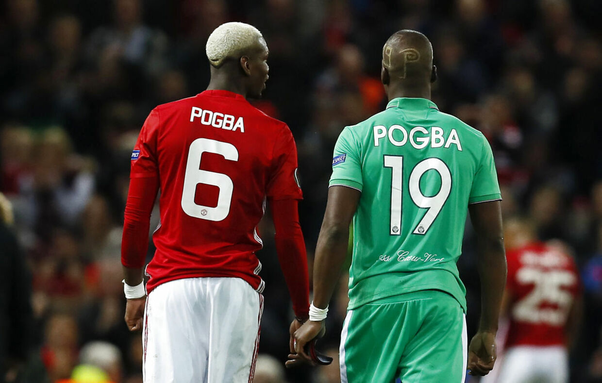 Britain Football Soccer - Manchester United v Saint-Etienne - UEFA Europa League Round of 32 First Leg - Old Trafford, Manchester, England - 16/2/17 Manchester United's Paul Pogba and St Etienne's Florentin Pogba after the game Action Images via Reuters / Jason Cairnduff Livepic