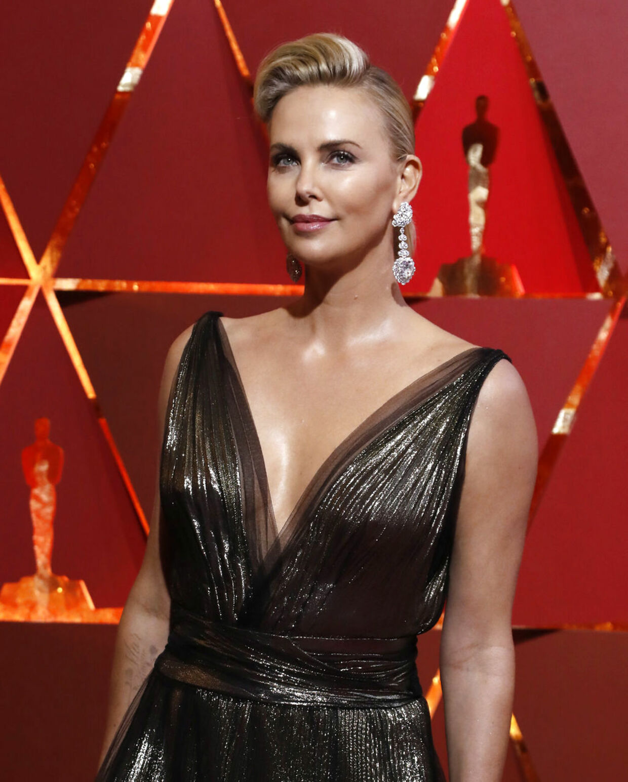 89th Academy Awards - Oscars Red Carpet Arrivals - Hollywood, California, U.S. - 26/02/17 - Charlize Theron wears Dior. REUTERS/Mario Anzuoni
