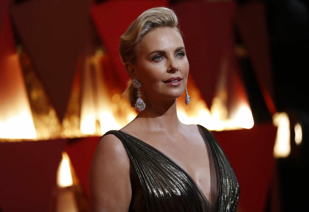 89th Academy Awards - Oscars Red Carpet Arrivals - Hollywood, California, U.S. - 26/02/17 - Actress Charlize Theron in Dior with Chopard jewelry. REUTERS/Mario Anzuoni