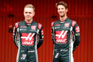 HAAS F1 Team's Danish driver Kevin Magnussen (L) and HAAS F1 Team's French driver Romain Grosjean pose during their official presentation at the Circuit de Catalunya on February 27, 2017 in Montmelo on the outskirts of Barcelona during the first test day of the Formula One Grand Prix season. / AFP PHOTO / JOSE JORDAN