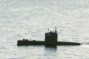 "(FILES) This file photo taken on August 10, 2017 shows a man and a woman standing in the tower of the private submarine ""UC3 Nautilus"" in Copenhagen Harbor. The trial of Danish submarine builder Peter Madsen, charged with murdering and mutilating Swedish journalist Kim Wall, resumes on March 21, 2018 as prosecutors are not convinced by his account that she died in an accident on board his vessel. / AFP PHOTO / Peter THOMPSON"