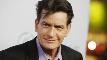 """Cast member Charlie Sheen poses at the premiere of his new film """"Scary Movie 5"""" in Hollywood, in this file photo taken April 11, 2013. Celebrity website RadarOnline.com and the National Enquirer tabloid on April 7, 2016 refused to hand over material sought by authorities investigating threats that those media reported actor Charlie Sheen had made against a former girlfriend. REUTERS/Fred Prouser/Files"""