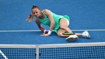 Slovakia's Magdalena Rybarikova falls during their women's singles third round match against Ukraine's Kateryna Bondarenko on day five of the Australian Open tennis tournament in Melbourne on January 19, 2018. / AFP PHOTO / SAEED KHAN / - - IMAGE RESTRICTED TO EDITORIAL USE - STRICTLY NO COMMERCIAL USE - -