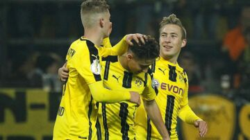 DORTMUND, GERMANY - OCTOBER 26: Jacob Bruun Larsen, Emre Mor(C) and Felix Passlack(R) of Borussia Dortmund celebrate scoring a goal during the DFB Pokal soccer match between Borussia Dortmund and 1.FC Union Berlin at the Signal Iduna Park stadium in Dortmund, Germany on October 26, 2016. Leon Kuegeler / Anadolu Agency