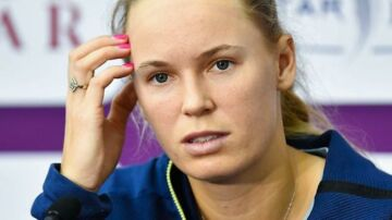epa06537565 Caroline Wozniacki of Denmark talks to the media after losing her semi final match against Petra Kvitova of the Czech Republic at the WTA Qatar Ladies Open tennis tournament in Doha, Qatar, 17 February 2018. EPA/NOUSHAD THEKKAYIL