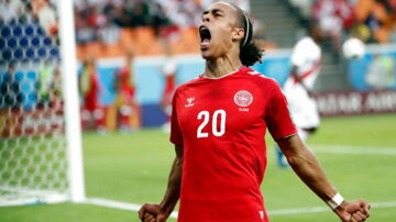epaselect epa06814015 Yussuf Poulsen of Denmark celebrates scoring the 1-0 during the FIFA World Cup 2018 group C preliminary round soccer match between Peru and Denmark in Saransk, Russia, 16 June 2018. (RESTRICTIONS APPLY: Editorial Use Only, not used in association with any commercial entity - Images must not be used in any form of alert service or push service of any kind including via mobile alert services, downloads to mobile devices or MMS messaging - Images must appear as still images and must not emulate match action video footage - No alteration is made to, and no text or image is superimposed over, any published image which: (a) intentionally obscures or removes a sponsor identification image; or (b) adds or overlays the commercial identification of any third party which is not officially associated with the FIFA World Cup) EPA/ERIK S. LESSER EDITORIAL USE ONLY EDITORIAL USE ONLY