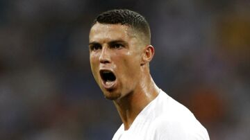 FILE - In this file photo dated Saturday, June 30, 2018, Portugal's Cristiano Ronaldo reacts during the round of 16 match between Uruguay and Portugal during the 2018 soccer World Cup at the Fisht Stadium in Sochi, Russia. Cristiano Ronaldo is leaving Real Madrid it is announced Tuesday July 10, 2018, to join Italian club Juventus, bringing to an end a hugely successful nine-year spell in Spain. (AP Photo/Francisco Seco, FILE)
