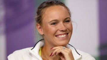 Denmark's Caroline Wozniacki takes part in a press conference on the eve of the 2018 Wimbledon Championships at The All England Tennis Club in Wimbledon, southwest London, on July 01, 2018 / AFP PHOTO / POOL AND AFP PHOTO / Jed LEICESTER / RESTRICTED TO EDITORIAL USE